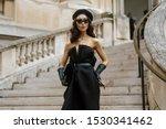 Small photo of PARIS, FRANCE - SEPTEMBER 25, 2019: A guest wearing a beret and black Maison Margiela dress seen outside MAISON MARGIELA show, during Paris Fashion Week Womenswear Spring/Summer 2020.