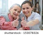 Senior Woman And Female Nurse...