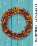 autumn wreath on a wooden...   Shutterstock . vector #1530816995