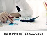 Small photo of Accountant using a calculator to calculate the numbers. Accounting , Accountancy from financial report and calling to consultant, Calculation Concept.