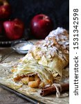 Small photo of Homemade apple strudel with toasted almonds, autumn baking, fresh apples. Rustic