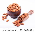 almonds in wooden bowl isolated ... | Shutterstock . vector #1531647632