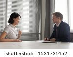 Small photo of Recruiter listening to young Asian candidate at job interview, confident applicant answering to recruiter questions, introduction, good first impression, recruitment process, human resources