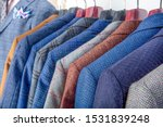 Men\'s Jackets On Hangers In Th...