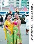Small photo of INDONESIA, BANDUNG - October 13, 2019: Photo Model - Two Sweet Exotic Women Original to Bali in Original Balinese Dresses