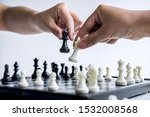 Small photo of Businessman and businesswoman playing chess and thinking about strategy crash overthrow the opposite team and development analysis for win and successful.