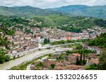 Panoramic view of Osum river in Berat, Albania with Old Town on one bank and Gorica on the other