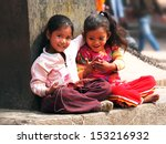 Kids Sitting On The Street Of...
