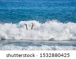 Surfer In Wave Wipes Out And...