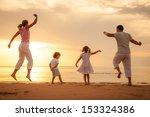 happy beautiful family dancing... | Shutterstock . vector #153324386