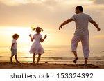 happy beautiful family dancing... | Shutterstock . vector #153324392
