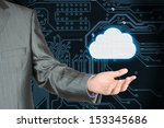Businessman with cloud on dark circuit board background, cloud computing concept  - stock photo