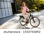 Young Woman Riding An Electric...