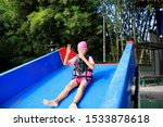 Girls Playing With Water Slide...