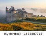 Ancient fortress in Khotyn in morning sun with mist, West Ukraine. Majestic fortification on the banks of the Dniester River, one of the most famous and largest castles in Ukraine.