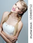blond woman with braid... | Shutterstock . vector #153403712