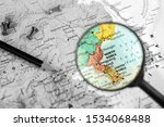 note device and magnifier selective at north korea and south korea map. - economic and travel concept.