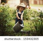 Cute Little Boy Watering...