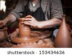 potter working a piece of clay | Shutterstock . vector #153434636
