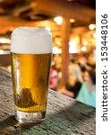 glass of beer in pub | Shutterstock . vector #153448106