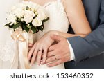 Bride And Groom's Hands With...