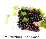 Grapes In Basket With Leaf On...