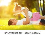 father and daughter in the park | Shutterstock . vector #153463532
