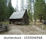 Log Cabin With A Stone Chimney...