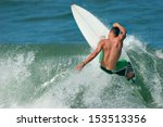 a surfer carves a radical off... | Shutterstock . vector #153513356
