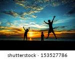 silhouette of family at dusk. | Shutterstock . vector #153527786