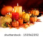 Candle And Pumpkins On A Autum...