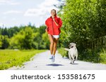 Stock photo young attractive sport girl running with dog in park 153581675