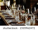 Small photo of beautifully laid tables with glasses and appliances at morning in restaurant