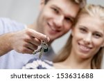 young caucasian man holding keys | Shutterstock . vector #153631688