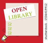 Conceptual hand writing showing Open Library. Business photo text online access to analysisy public domain and outofprint books Speaking trumpet on left bottom and paper to rectangle background.