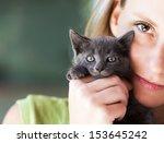 Woman Holding Cute Black Kitten