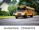 Yellow School Bus Driving Alon...