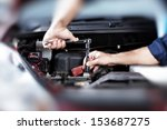 hands of car mechanic in auto... | Shutterstock . vector #153687275