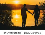 Silhouettes Of Two Lovers A Gu...