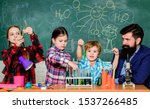 Stock photo school club education teacher and pupils test tubes in classroom chemistry themed club group 1537266485