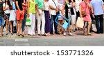 Crowd waiting to cross street - stock photo