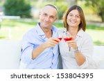 mature couple having an... | Shutterstock . vector #153804395