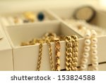 gold jewelry and pearls in a... | Shutterstock . vector #153824588