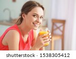 Young Woman Drinking Healthy...