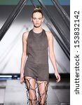 Small photo of NEW YORK, NY - SEPTEMBER 05: A model walks the runway at the Titania Inglis presentation during Mercedes-Benz Fashion Week Spring 2014 at The Standard Hotel on September 5, 2013 in New York City.