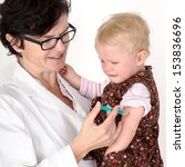 doctor injects small child in... | Shutterstock . vector #153836696