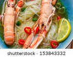Closeup of traditional Thai soup with scampi - stock photo