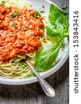 Spaghetti bolognese with shrimps and fresh herbs - stock photo