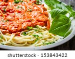 Closeup of spaghetti bolognese with shrimps - stock photo