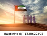 Emirati young men standing on...